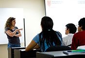 Photo by David Snyder for Fogarty/NIH. Dr. Patty Garcia lectures to a classroom of students.