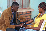 Medical worker takes a participant's blood pressure.
