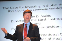 PHOTO: Dr. Jeffrey Sachs speaks in front of a screen showing his slides