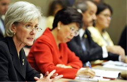 PHOTO: HHS Secretary Kathleen Sebelius speaks, seated at a table with others