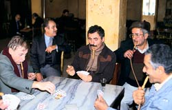 PHOTO: five men seated around table smoking water pipes
