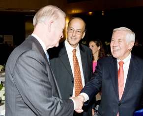 Sen. Richard Lugar greets Dr. Charles Sanders of the NIH Foundation at the Fogarty dinner while Dr. Roger Glass looks on.