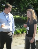 Scott Peterson talking to Vanderbilt University program coordinator Tiffany Patterson at Stone House the barbecue.