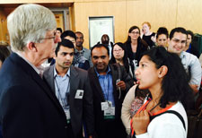 NIH Director Dr Francis Collins speaks with fellows and scholars during 2015 orientation while standing in hallway