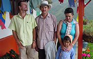 A family in Colombia on the porch, mountains in background