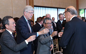 NIH and Japanese leadership raise a glass to make a toast during the HFSP 30th anniversary reception.