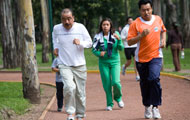 People of all ages get exercise by jogging on a track in Mexico