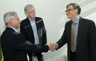 Bill Gates shakes hands with NIAID Director Dr. Anthony Fauci, NIH Director Dr. Francis Collins looks on