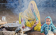 © 2014 Louis Kleynhans, Courtesy of Photoshare, A woman cooks supper in Rajasthan, India